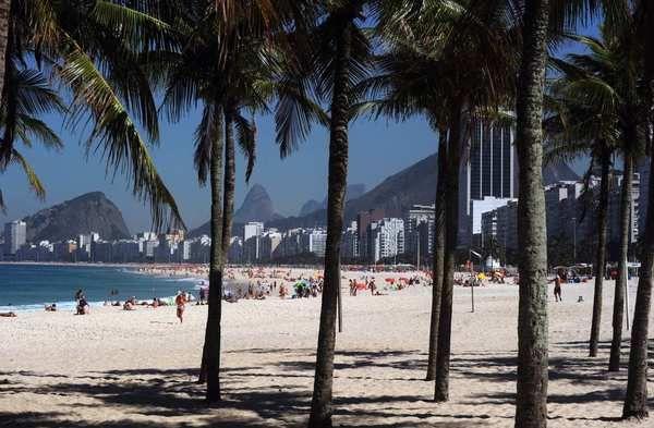 An idyllic scene is presented through the trees at Copacabana beach in Rio de Janeiro. Just BEAUTIFUL!