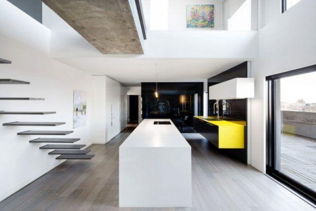 Raumgestaltung ideen betondecke kuecheninsel schwebende treppe
