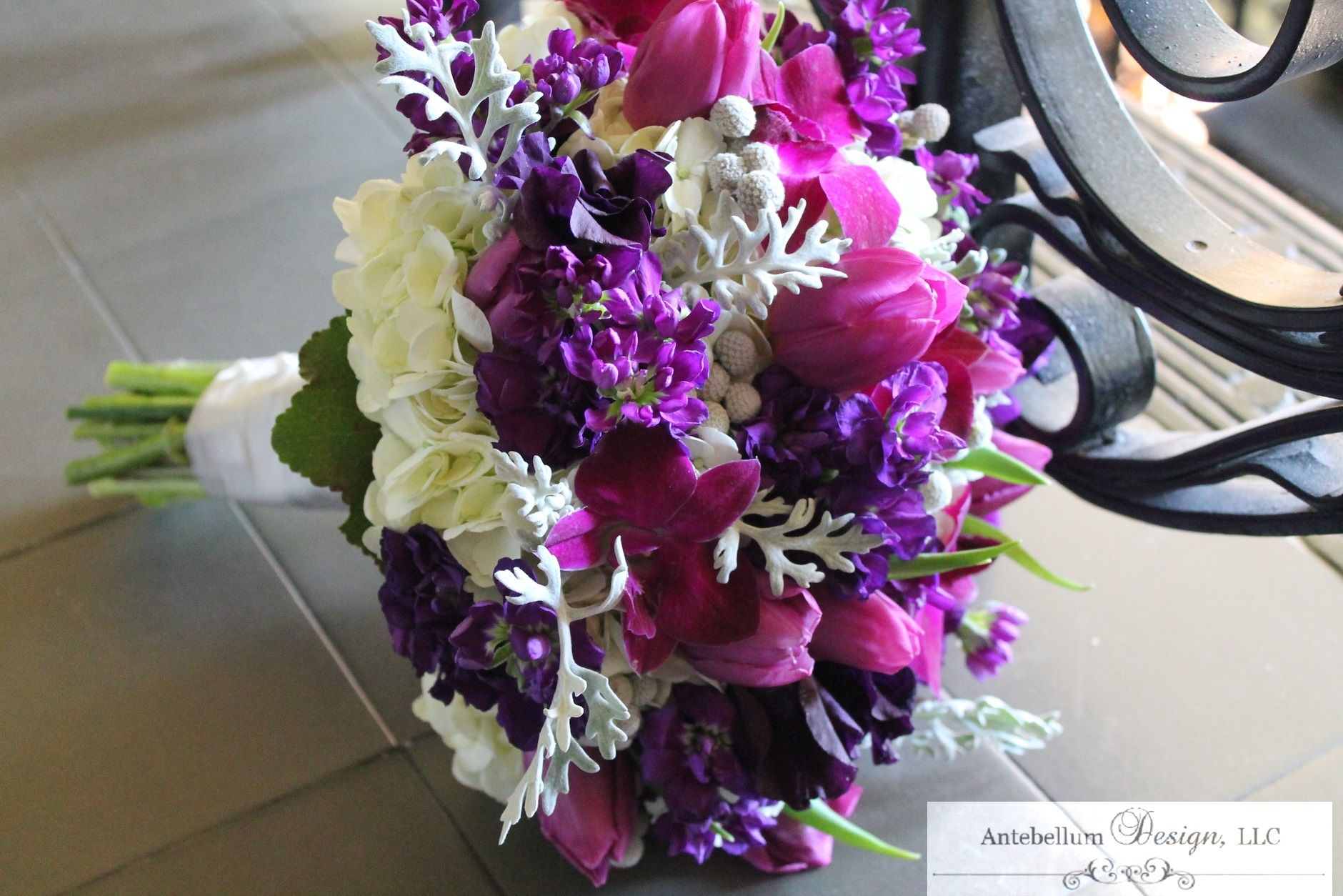 purple wedding flowers in bouquet with purple tulips and orchids by AntebellumDesign.com