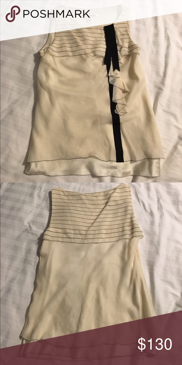 Diane Von Furstenberg sleeveless blouse Ivory silk top with black detail. Lined. Very flirty and flattering. Diane von Furstenberg Tops Blouses