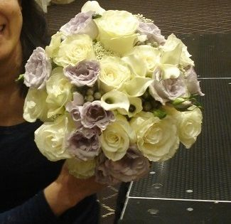 Bridal bouquet with roses and mini  calla lilies. For more information, please visit us at www.plushflowers.ca