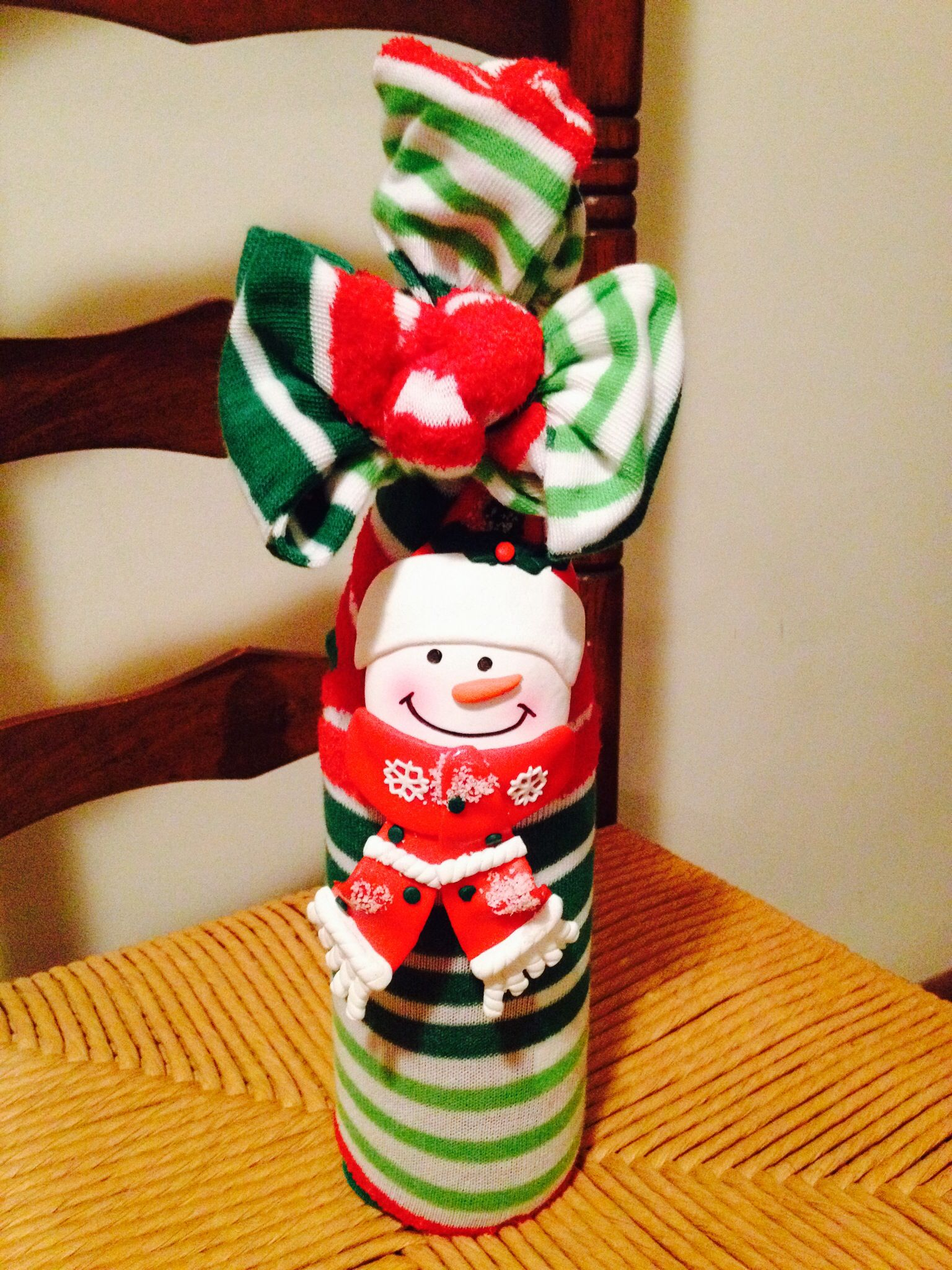 Wine, christmas socks, and a bottle neck decoration make a great ...