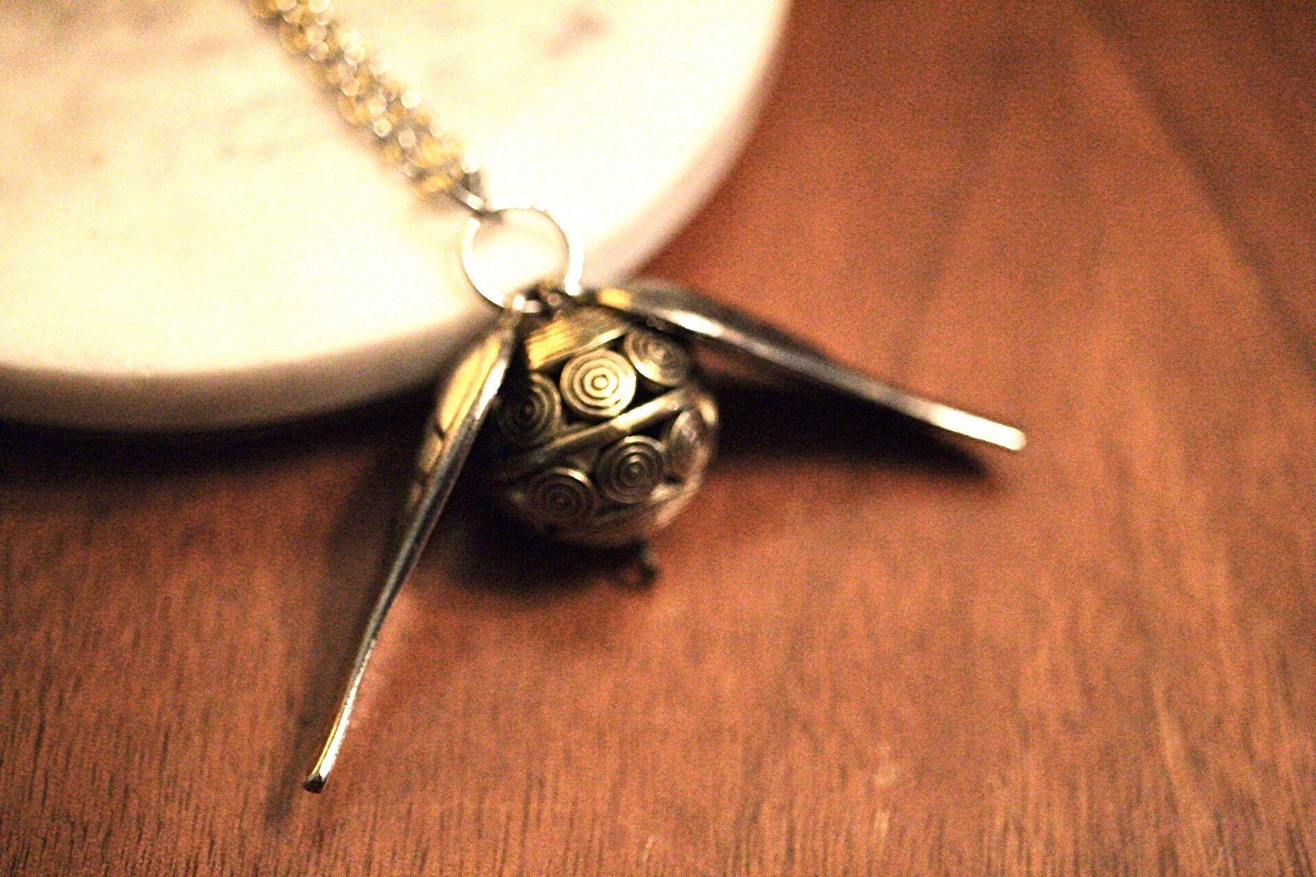 Photo of Harry Potter inspirierte goldene Schnatz-Halskette