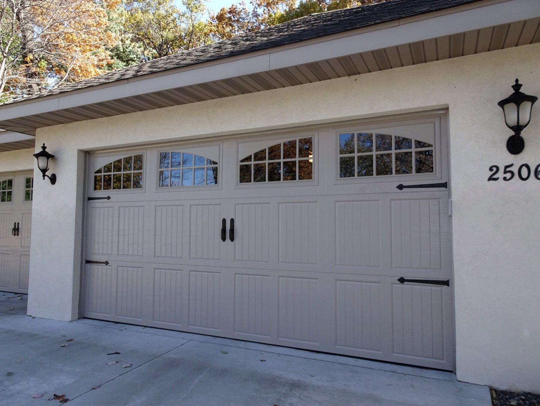 Amarr Classica In Sandstone With Tuscany Panels And Seine Windows Garage Door Design Garage Door Styles Garage Doors