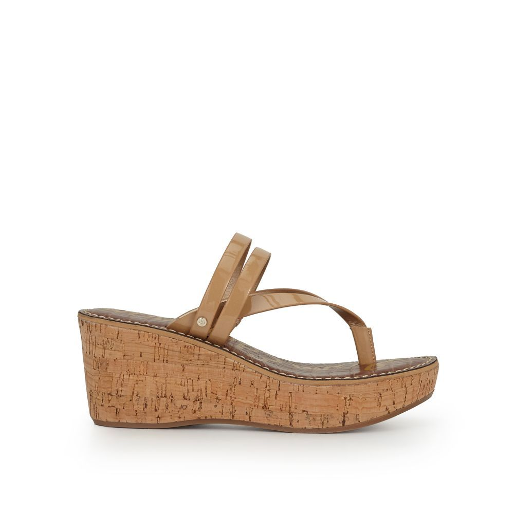 931319c8e0 Our Rasha Wedge Sandal adds height and style. With its tall, cork sole and  the strappy leather details, this is going to be your go-to platform.