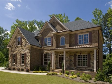 Brick and stone create classic style in this newly built for Custom built brick homes