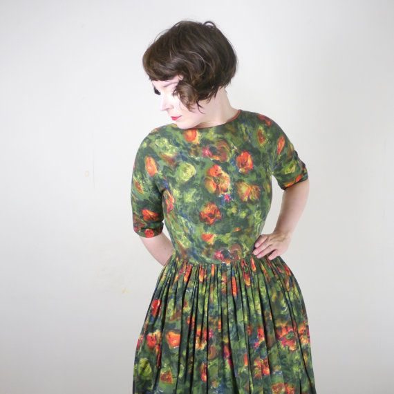 Beautiful Peggy Page 50s dress in a lovely autumnal forest green with almost abstract painterly floral highlights in yellow and orange. Fitted