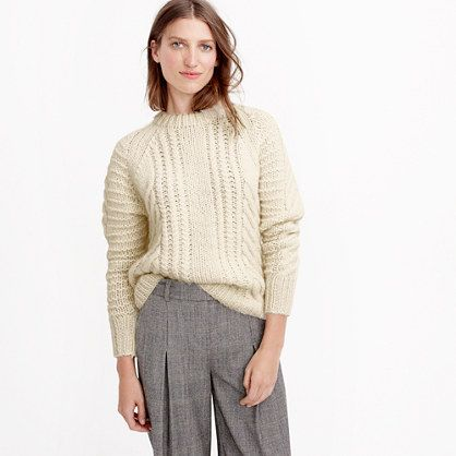 A fun cable-knit sweater in cozy wool. This version features a ...