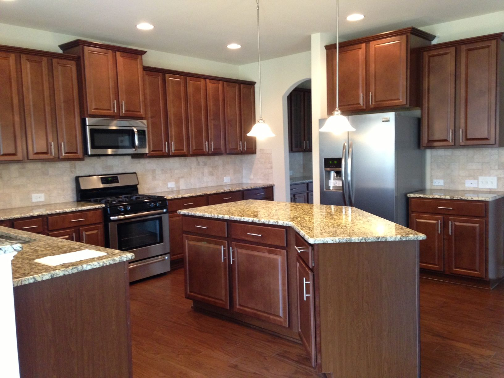 Genial Wakefield Kitchen. Timberlake Andover Maple Nutmeg Cabinets. Santa Cecilia  Granite. Tavertine Ivory Backsplash