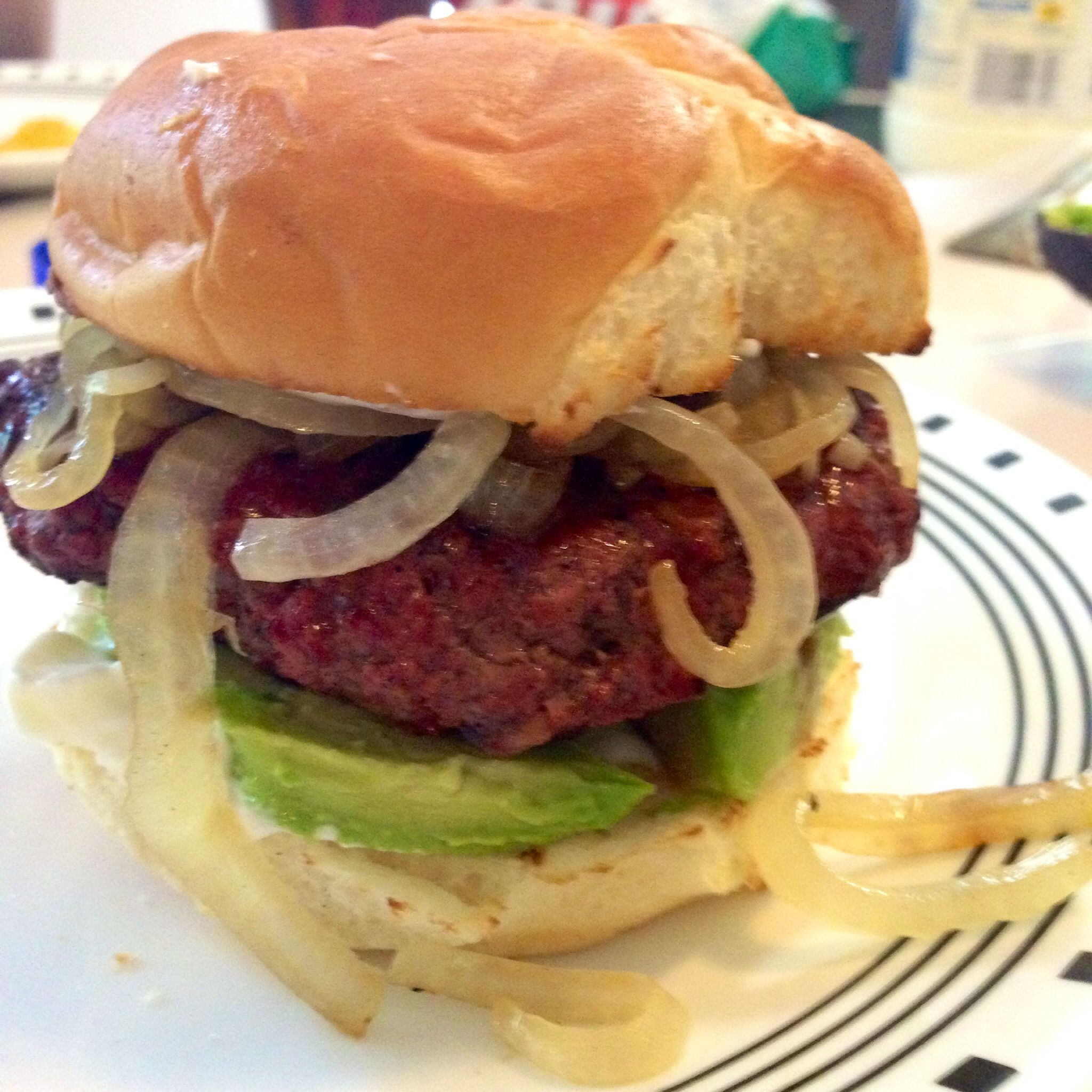 BBQ burger with grilled onions and avocado.