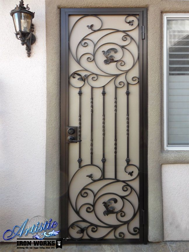 Elegantly scrolled wrought iron security screen door for Wrought iron security doors