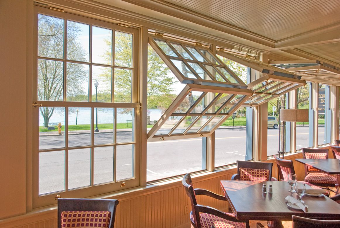 The Double Hung Folds Up Toward The Ceiling Reminiscent Of