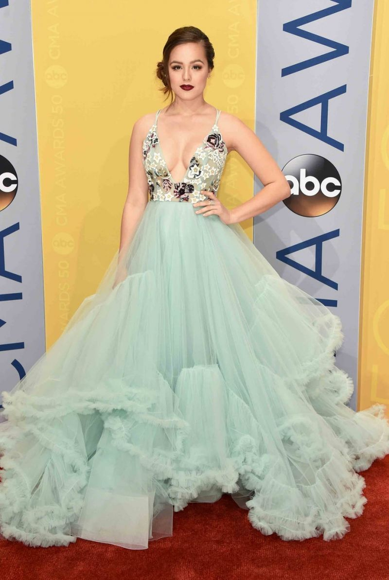 Hayley Orrantia in a floral mint gown at the red carpet of CMA ...