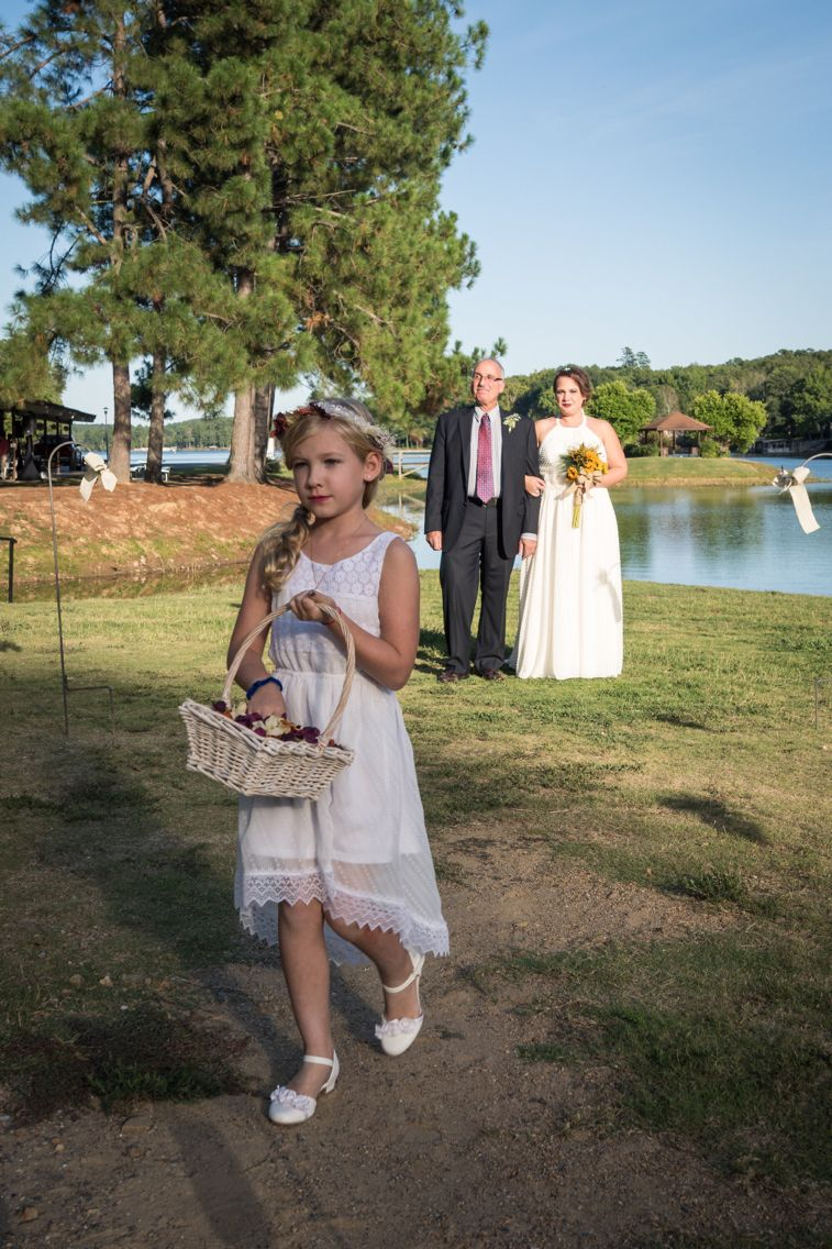 Flowergirl starting her walk down the isle  Photo by Harold George Photography out of Allen, Tx