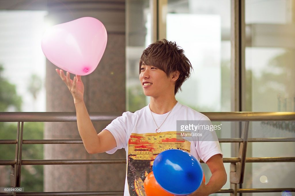 Asian young boy playing colorful balloon