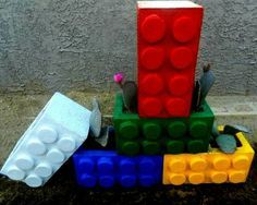 How To Recycle Cinder Blocks Into A Colorful Lego Planter!!! Bebe'!!! Cute idea...darling container!!!
