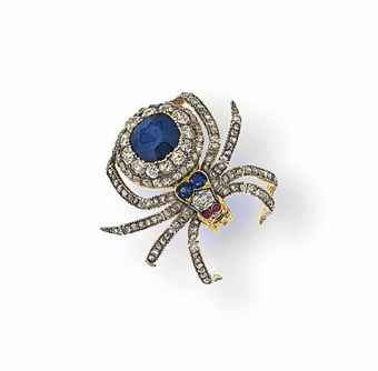 A late 19th century sapphire and diamond brooch Modelled as a spider, the body set with a cushion-shaped sapphire within a pavé old-cut diamond surround to a sapphire and diamond three-stone head with cabochon ruby eyes, between eight rose-cut diamond legs, mounted in silver and gold, circa 1880, detachable brooch fitting, fitted case, 4.0cm long
