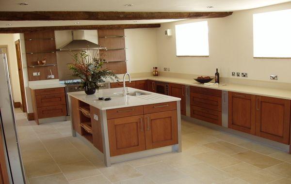 wood cabinets, white concrete counters, bone colored concrete floor