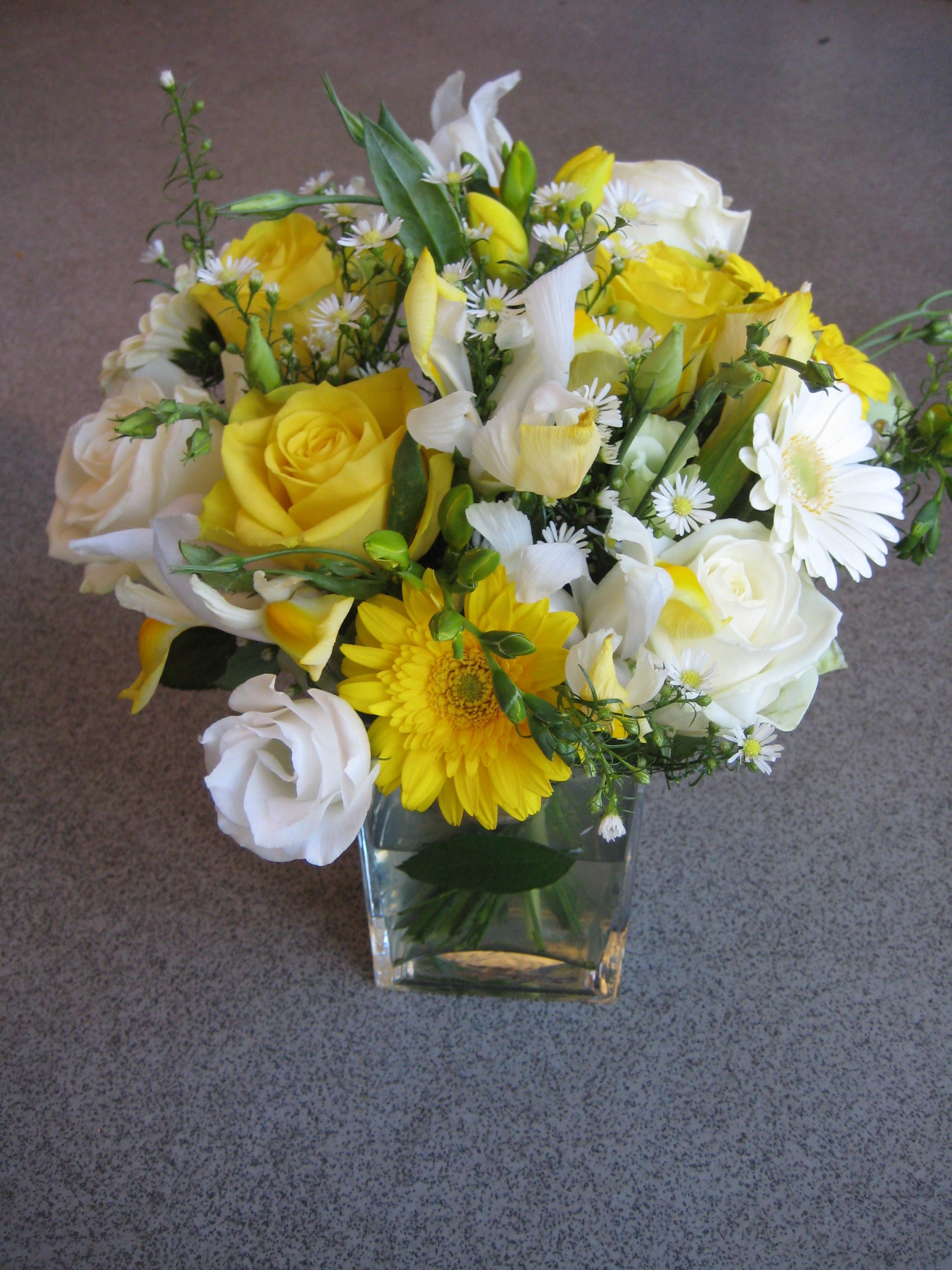 A passionflower table centrepiece in yellows and whites