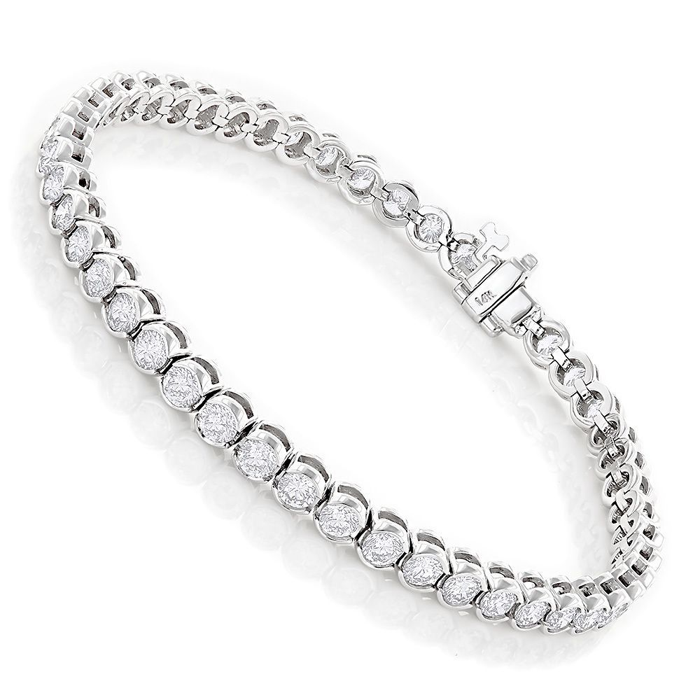 This elegant tennis bracelet features a radiant 14-karat gold frame in your choice of white, yellow or rose-gold. Round-cut diamonds in a half bezel setting lend a shimmering touch, while a connector clasp offers secured wear.