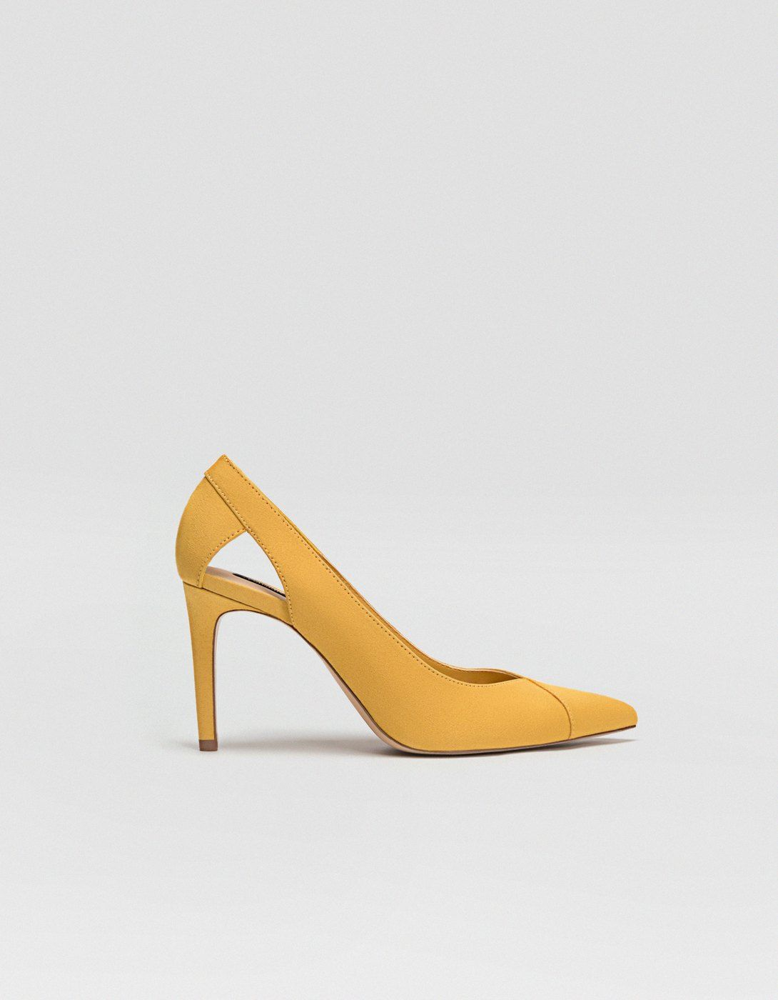 64b787bc2b Mustard yellow cut-out high-heel court shoes - Heel shoes | Stradivarius  Costa Rica