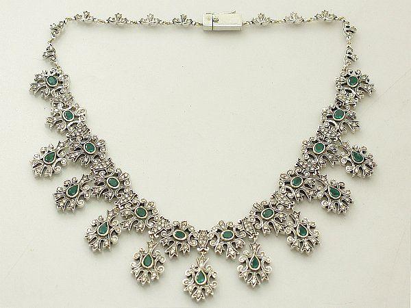 This stunning vintage emerald drop necklace set with 5.25 carat emeralds and 5.47 carat diamonds in silver and 9 carat yellow gold is one of our favourites here at AC Silver. We just wish we had a ball (or wedding) to wear it to! SKU: A1363 Price: GBP £6750.00 http://www.acsilver.co.uk/shop/pc/5-25-ct-Emerald-and-5-47-ct-Diamond-Silver-Set-Necklace-Vintage-Circa-1950-168p6926.htm#.VKu6Qy6_AR0 #emerald #necklace #vintage #diamond #fancy #wedding
