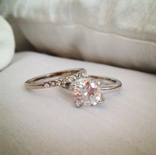 Looks Like A Blush Colored Diamond Which I Love Not Crazy About The Band