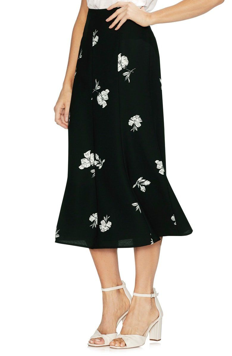 a3a4a7e66cb9 A bold floral print makes a modern statement on this flowy midi skirt.