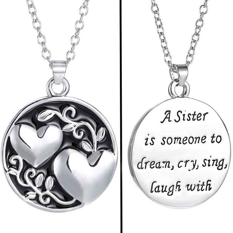 """Celebrate your favorite sibling with this playful """"sister"""" double sided charm pendant Metal: Alloy with Rhodium finish Length: 18"""" 8g Photos are enlarged to show details"""