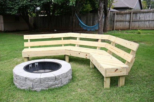 Lays A Wooden Frame In His Backyard, Then Flips It Over To Create A Stunning Fire Pit Bench This Project For A DIY Fire Pit Bench Will Turn Your Yard Into The Perfect Neighborhood HangoutThis Project For A DIY Fire Pit Bench Will Turn Your Yard Into The Perfect Neighborhood Hangout