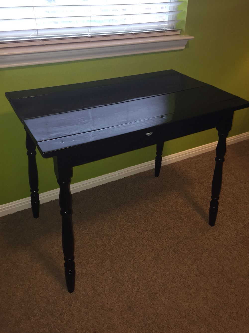 This is my Grandmother Trinidad Trevino's antique table. My husband repainted to match my craft room.