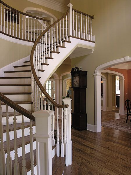 Beautiful entry! love the curved stairs and staircase! #entryways ...