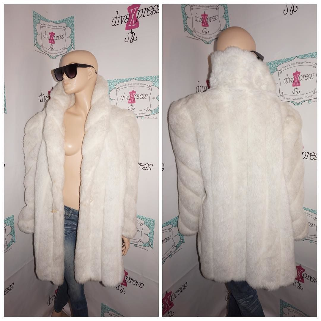 """Up for sale is this lovely Vintage American Sign White Faux Fur Coat Size 2x  Flaws: small stains inside of lining  Material:  acetate Shoulder Pads: yes Pit to Pit: """" 24 Sleeve: """" 16 Overall Length: """" 34  PLEASE READ Below Tag size on vintage clothing doesnt match current clothing sizes. Please compare the actual garment measurements below to your own clothing (not your body) to determine fit. Measurements have been taken with the garment lying flat. They have not been doubled. The tag…"""
