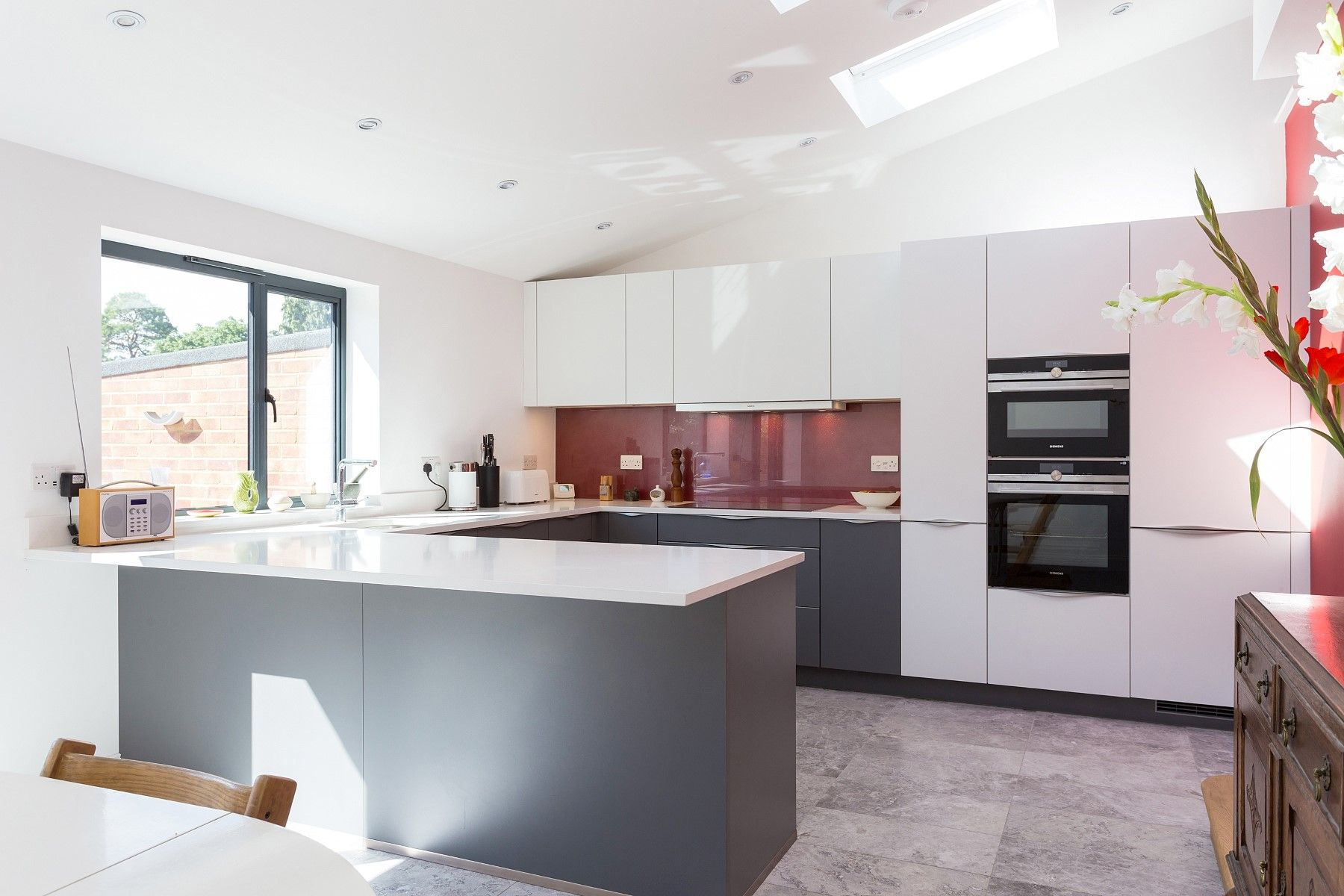 Matt Quartz Grey And White Nolte Kitchen With Top Mounted Handles And Sparkly Red Glass Splash Backs Bespoke Kitchen Design Kitchen Design Kitchen Inspirations