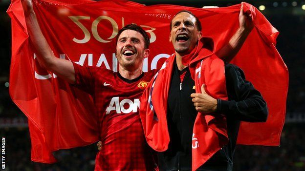 Michael Carrick and Rio Ferdinand of Manchester United