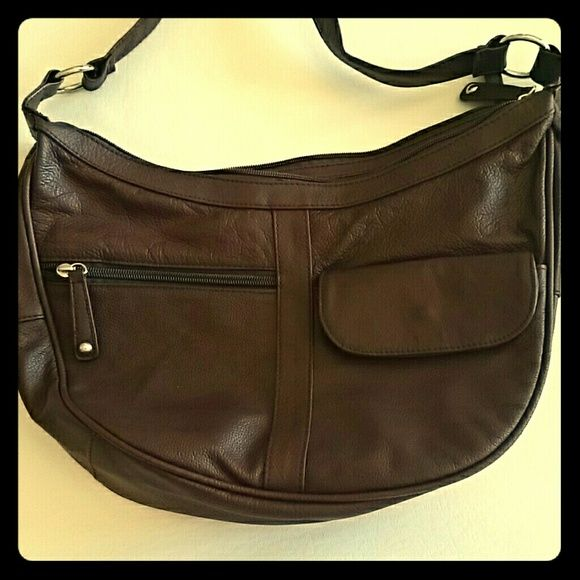 Real Guienue Leather Purse Slightly used. Real leather. Has 3 outside pockets. 3 inside pockets and two separate sides. No rips or stains. Bags Satchels