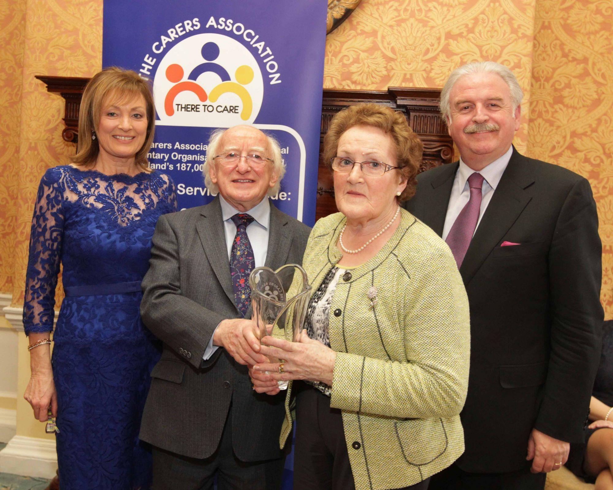 President Michael D Higgins acknowledges life long carers