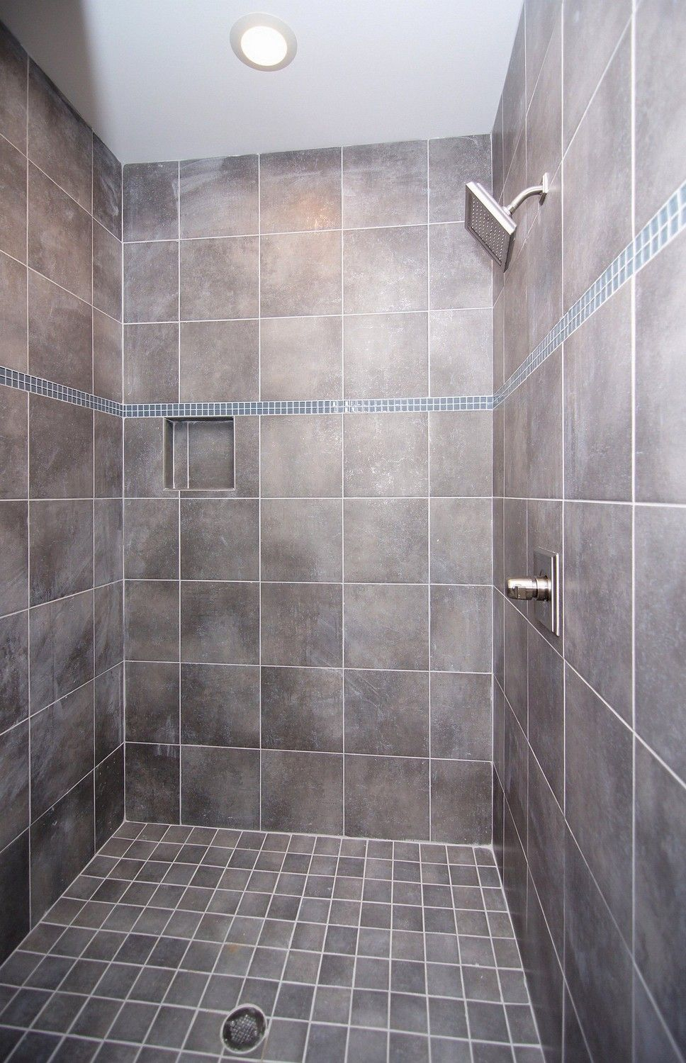 Gray tile shower with square shower head in master bathroom ...