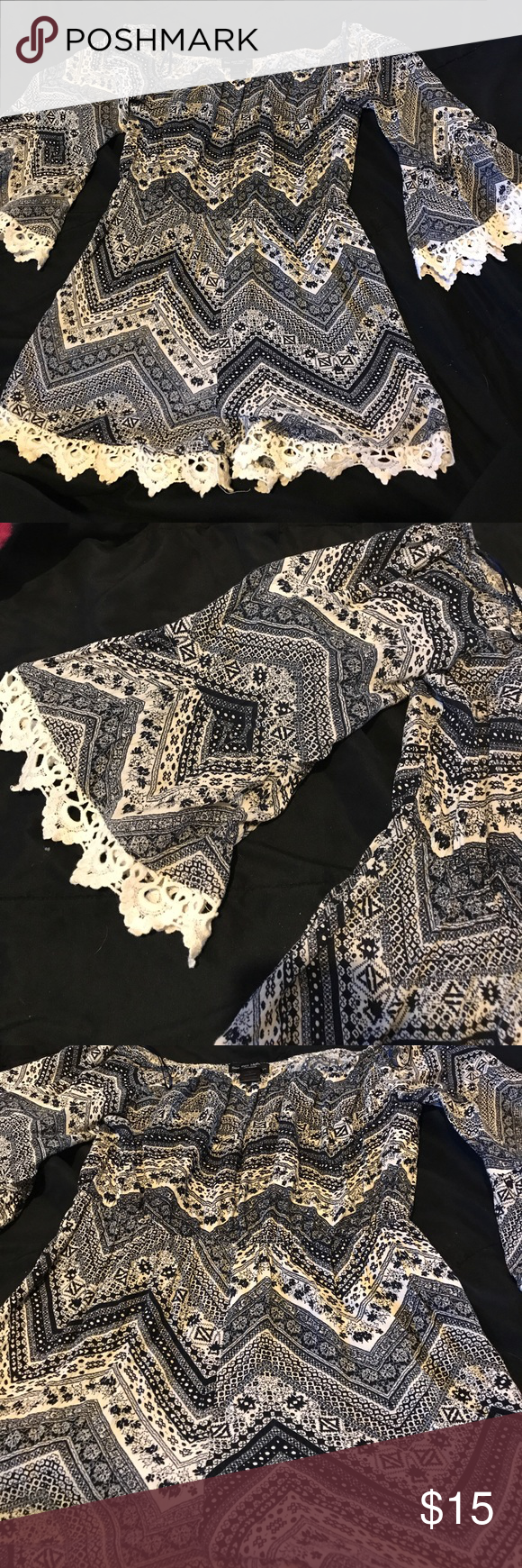 Romper Adorable romper from Ross! Was worn only once for an anniversary outing and hasn't been worn since. In great condition and super super cute! Features lace around the edges of the arms and bottom of shorts. Has flare sleeves See You Monday Dresses