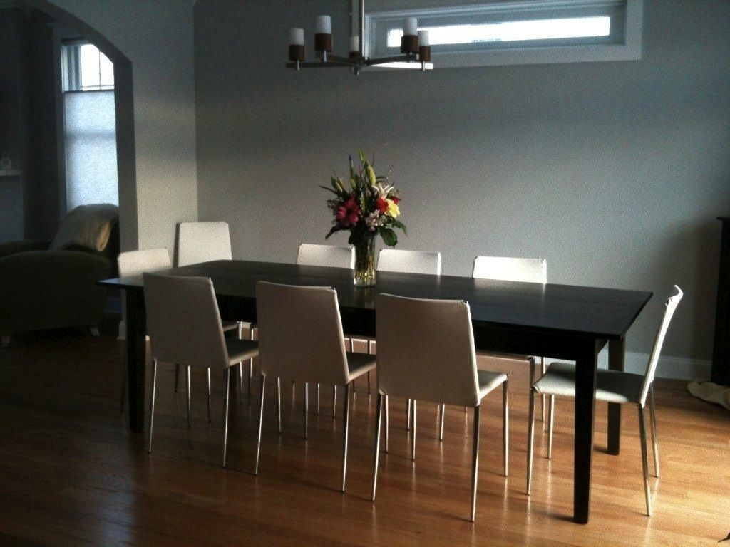 Black wash dining table in NYC modern apt From ECustomFinishes