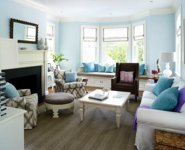 Love all the seating in this family room...bright and inviting. I love the combination of fabrics in this space.