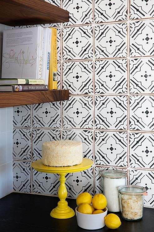 Black And White Tile Backsplash black and white kitchen features a soapstone countertop and a