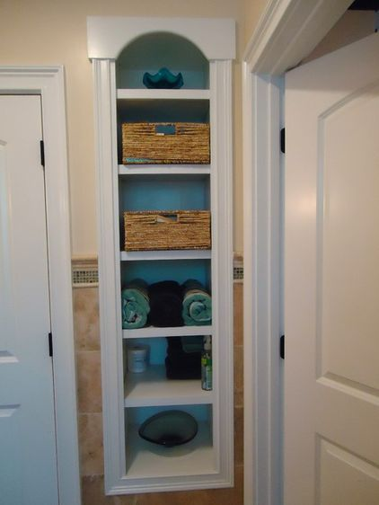 No wall space is too skinny for shelving. It's generally pretty easy to retrofit a bath with recessed units, especially if you can place them between wall studs.