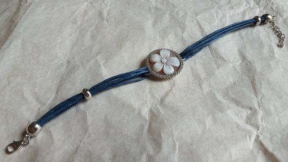 Handmade cameo bracelet set in 925 sterling silver with zircons and at last a dark cotton cord has been inserted.