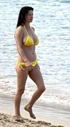 91242d7b1a6 enjoys holiday time on the island with her husband Michael Douglas