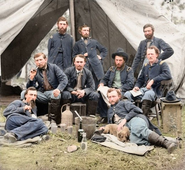 This photograph by Andrew Gardner depicts the staff of Brigadier General Andrew Porter in 1862. George Custer (of the Battle of Little Bighorn fame) is shown reclining next to a dog on the right.