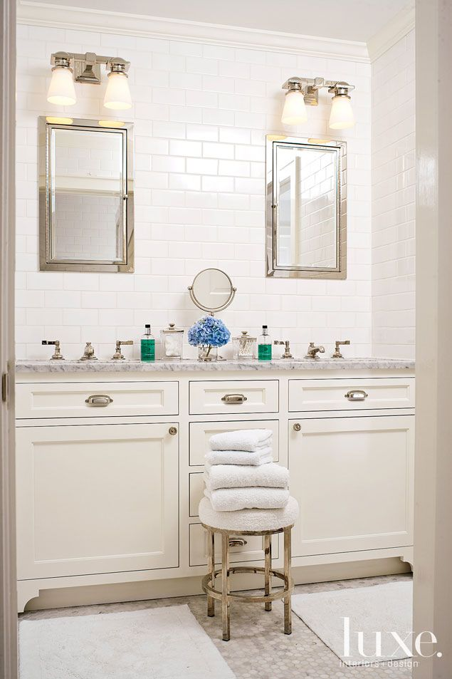 a jack and jill bathroom was outfitted with restoration hardware medicine cabinets as well as