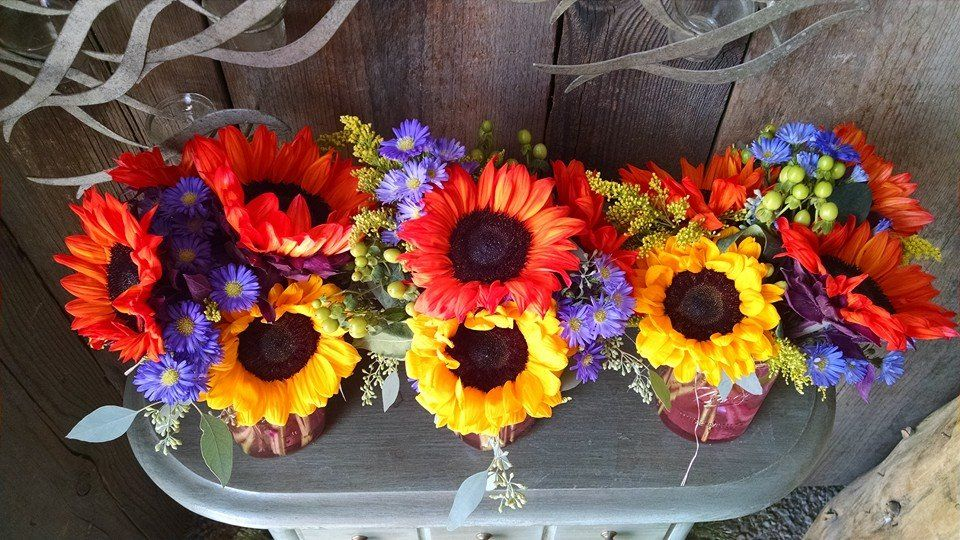 Bright red and yellow sunflowers for a fun filled barbque dinner.