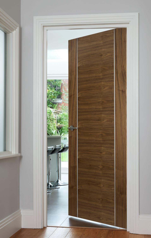 Orense Walnut Fd30 Bespoke Door Contemporary Style Door Features Stunning Stainless Steel Inlay Midcentury Interior Doors Contemporary Hallway Walnut Doors