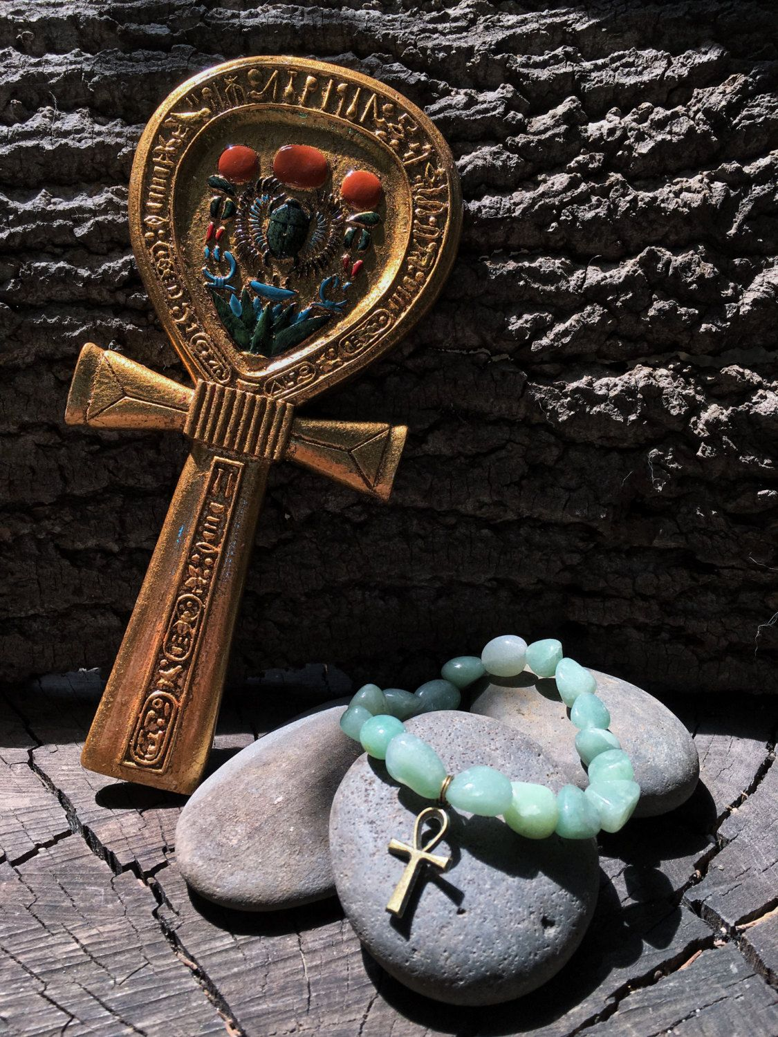 This egyptian inspired ankh bracelet is made of natural green aventurine tumbled gemstone stimulating love prosperity to balance the heart chakra aka 4th chakra the ankh cross is an egyptian symbol for eternal buycottarizona Choice Image
